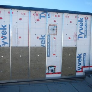 595 Pandora St. - Building wall covered with vapour barrier, z girts and some insulation.