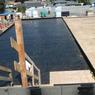 SBS roofing on Dunsmuir Middle School - A completed lower roof area