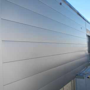 595 Pandora St. - Expertly installed metal siding, wrinkle free